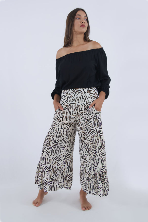 Photo of our Gypsy elasticated waist trousers for women. Summer cropped trousers in black and white zebra print.