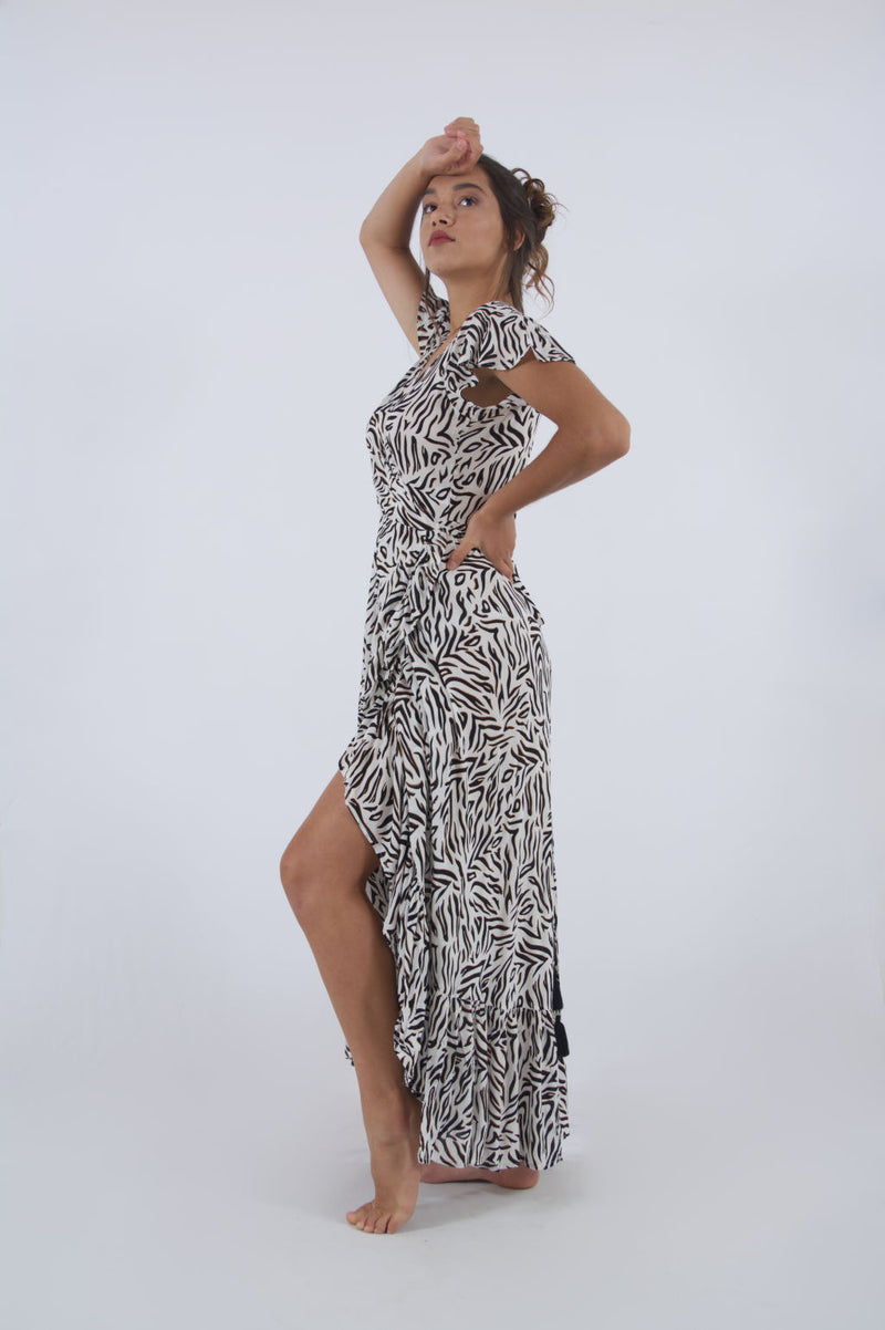 Side view of our elegant cocktail dress wrap. Our maxi, zebra print summer outfit.
