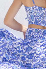 Detail of summer skirt in blue floral print.