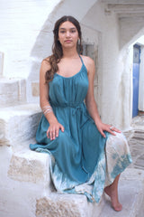 Image showing model with a long blue summer dress photographed in the Greek islands.