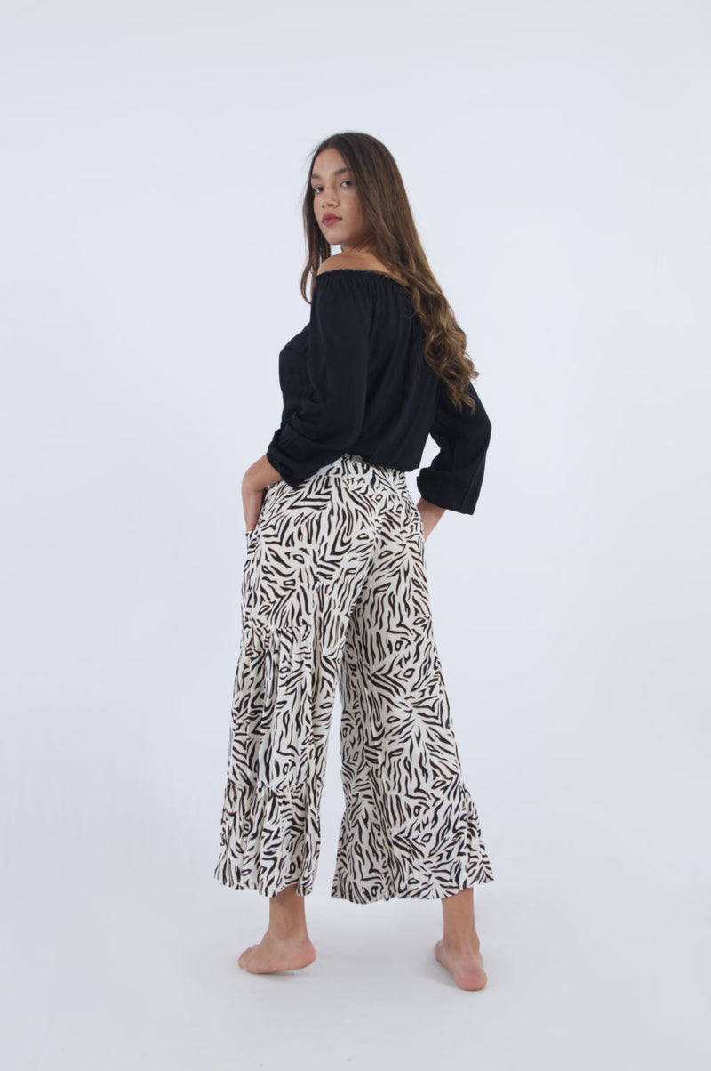 Ladies pull on trousers in zebra print. Flowy rayon summer trousers 3/4 length.