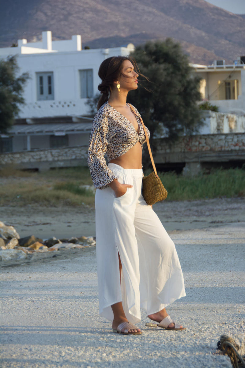 Loose fit summer pants, white with asymmetric hemline