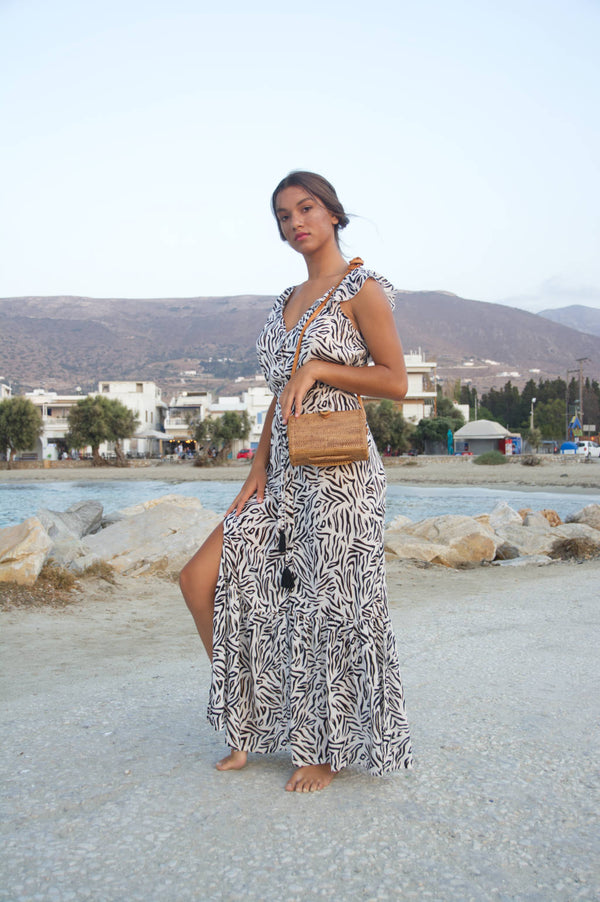 Long summer dress with side slits, tufted string belt and open back.