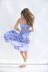 Light summer skirt with slit in blue floral print and matching top - back side