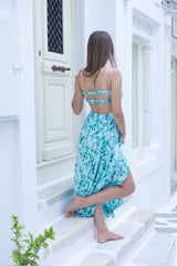 Long summer dress in blue floral print with open back, ideal for formal occasions - backside view