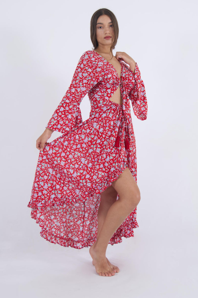 Side view of model wearing a long summer dress with crop top, long bell sleeves and sexy slit.