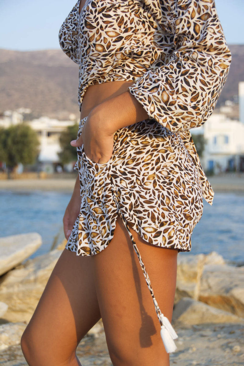 Shorts with small side lace-up detail, in gold pattern.
