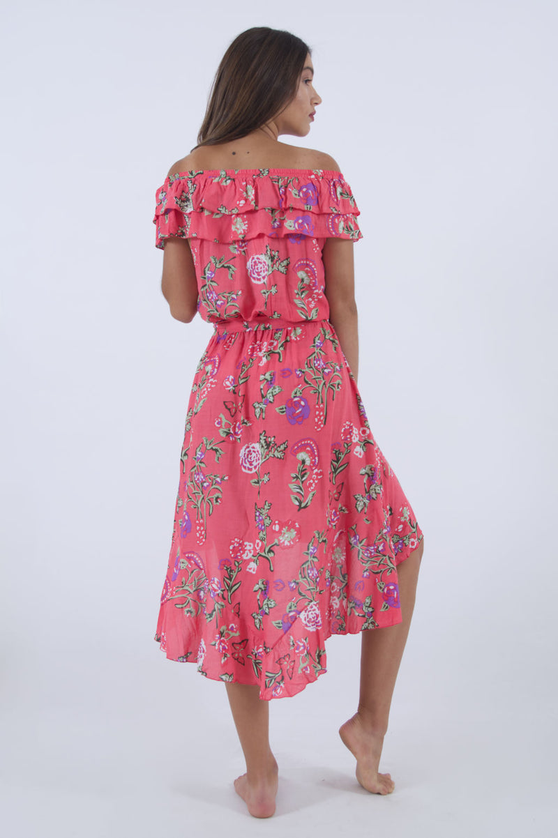Back side of our summer dress in pink floral pattern with ruffle off shoulder and high low cut.