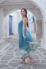 Low back summer dress, halter neck, in blue color with tie dye frill at the bottomlong.