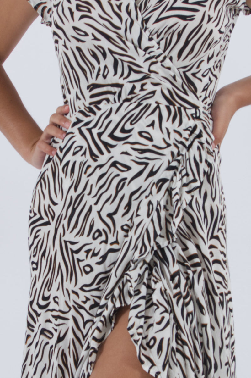 Detail of our zebra print dress from out wrap clothing line. Maxi and elegant.