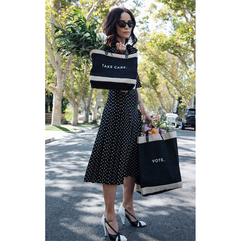 "Market Bag in Black for Abigail Spencer with ""VOTE."""