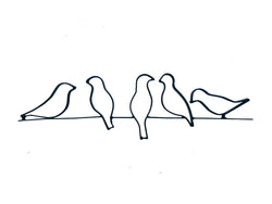 Metal birds on wire wall decor