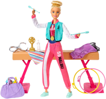 Load image into Gallery viewer, Barbie! You can be ANYTHING! with this set you can be a gymnast! Barbie can tumble, twist and turn with the balance beam and 15 + accessories, pretend you have won the Olympics and win trophies and medals, all included in the Barbie Gymnast set.  Barbie is wearing a colourful metallic leotard and she can do an outfit change with the extra outfits included with the se