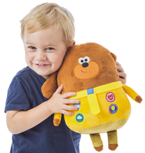 Load image into Gallery viewer, Hey Duggee Hug n Woof is the super fun interactive toy for your little one, press the badges to hear music and sounds, you child will be taking this cuddly toy everywhere with them.