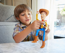 Load image into Gallery viewer, Woody is brought to life! This fantastic loveable Pixar character has 15+sounds and phrases for your little ones to enjoy and pretend they are to in the movie Toy Story! Re-live your favourite movie moments with this fully articulated talking figure!