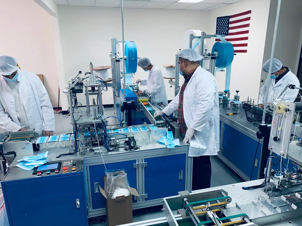 Technicians working on our automated mask making machines in San Diego, CA, USA