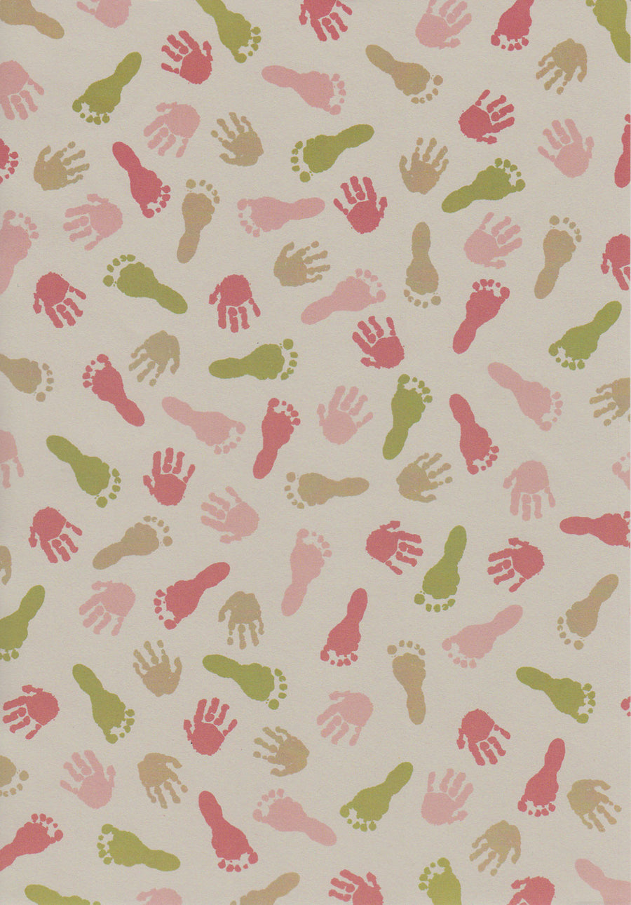 Children hand and feet imprints on paper