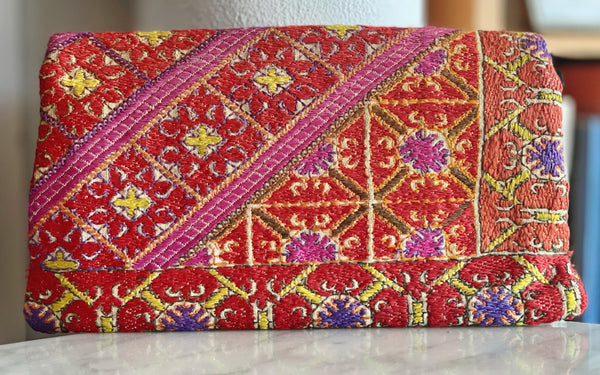 Vintage Indian leather and embroidered clutch