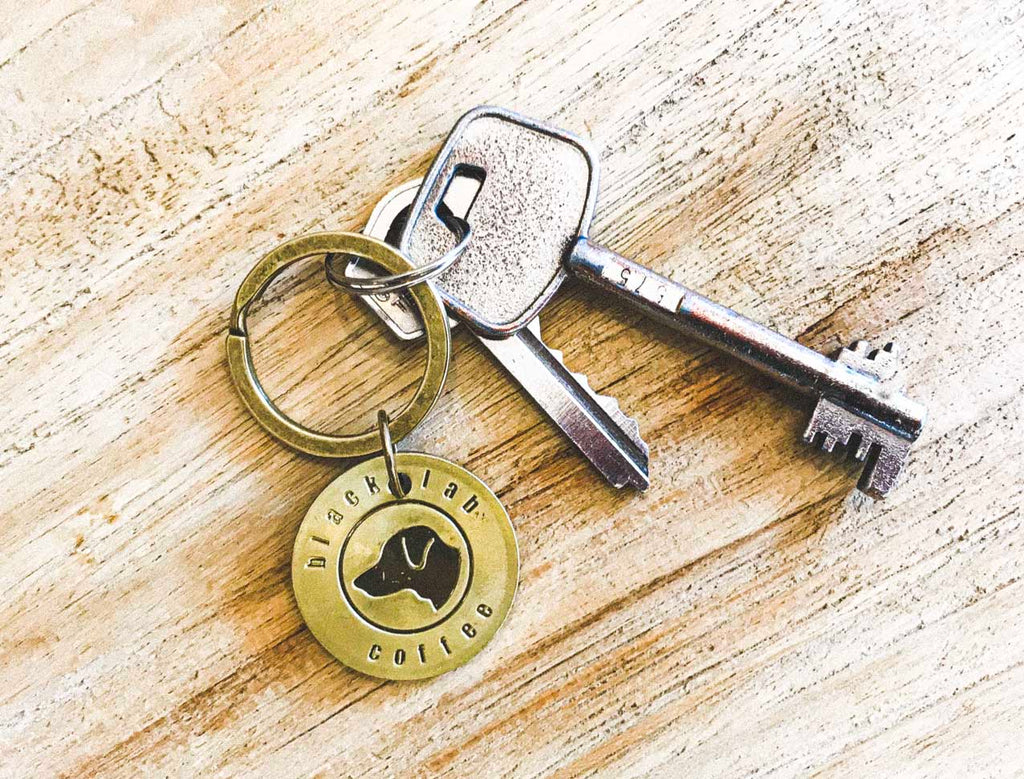 Key chain with key on timber