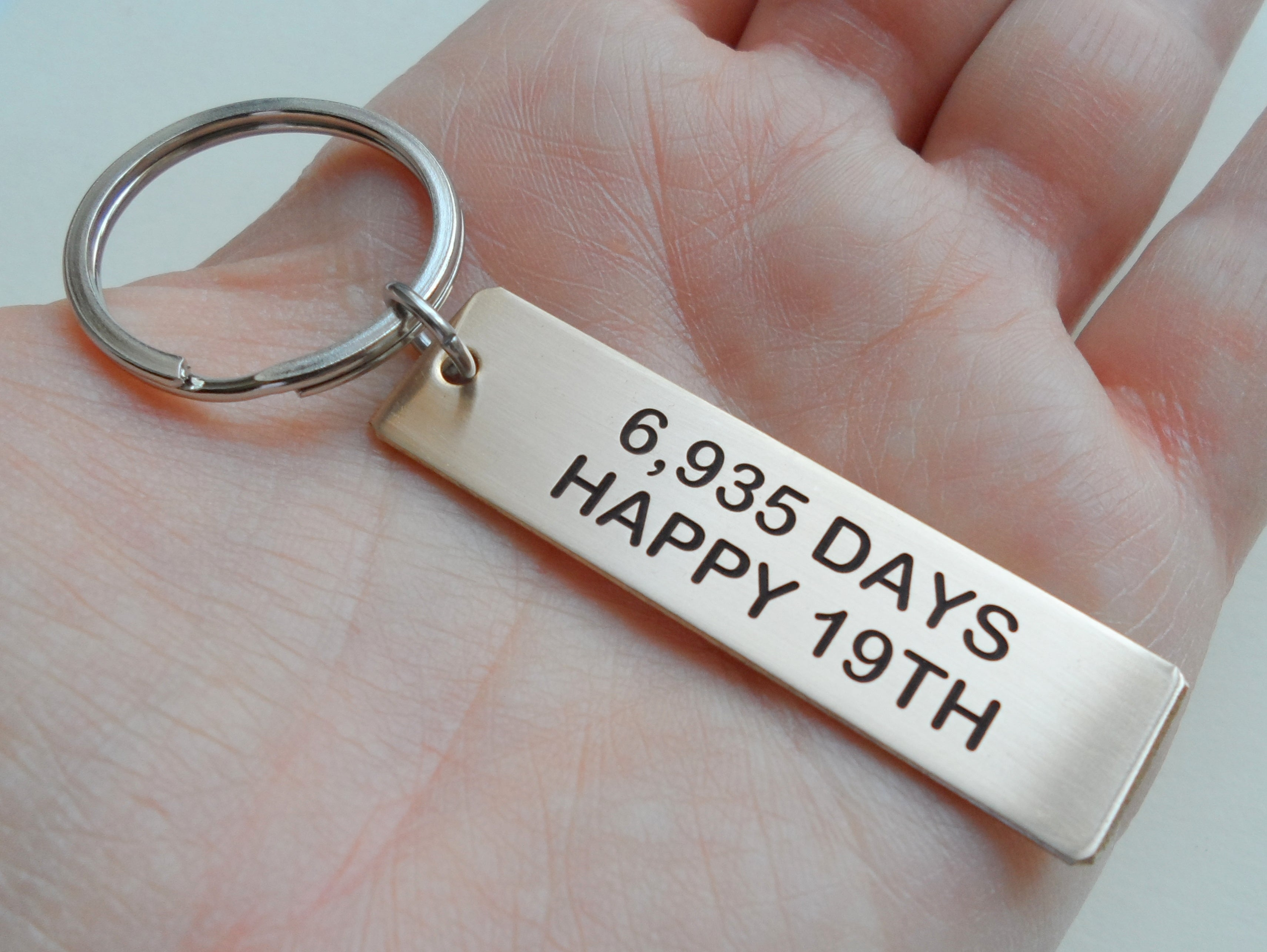 Gift For 19th Wedding Anniversary: Bronze Tag Engraved W/ 6,935