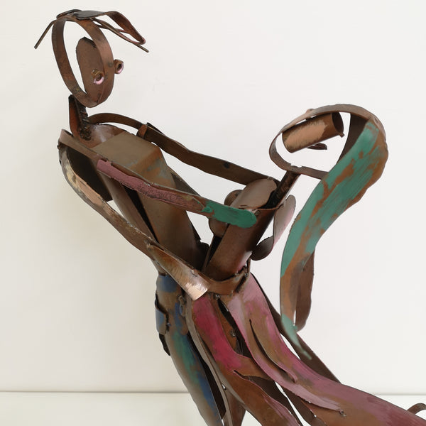 Dancing boy and girl sculpture