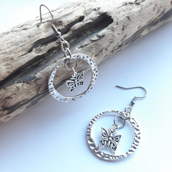 Silver butterfly in circle earrings
