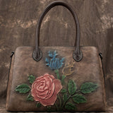 Multi-pocket embossed handbag