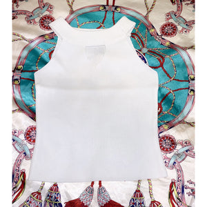 White croptop with cut-out décolletage detail