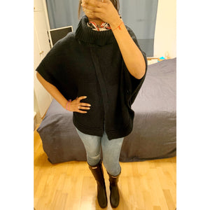 Vintage navy blue poncho sporting a stylish slit