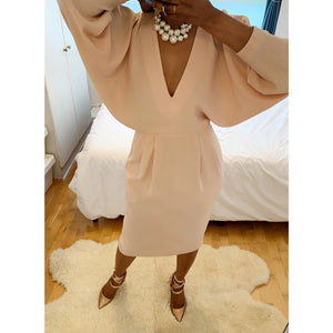 Regal blush midi dress with bat-sleeved cape-effects