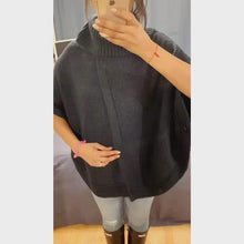 Load and play video in Gallery viewer, Vintage navy blue poncho sporting a stylish slit