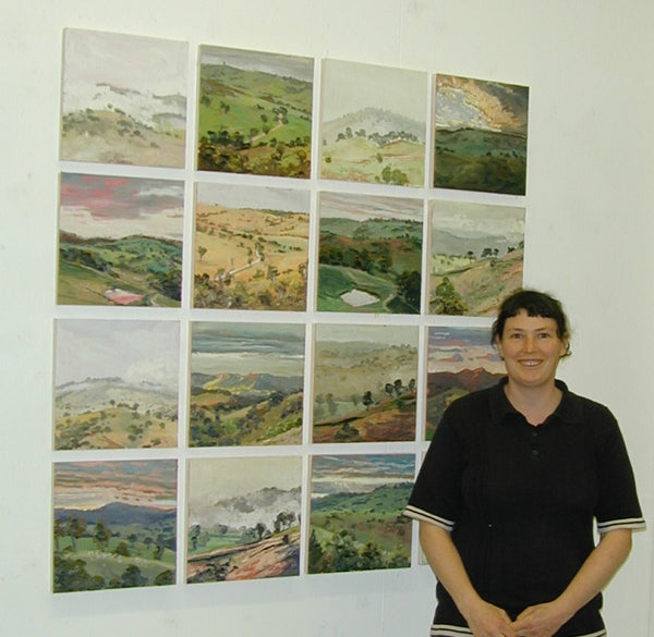 Lucy Culliton in front of Hartley Landscape at Ray Hughes Gallery 2002