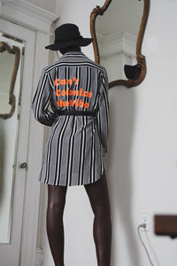 Can't Colonize The Vibe | Striped Tunic with Neon Orange Graphic