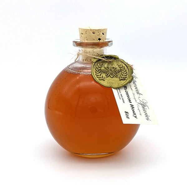 Shipwreck Apiaries Raw Honey 8oz glass flagon in both Blackberry Blossom Honey or Wildflower Blossom Honey Front Label