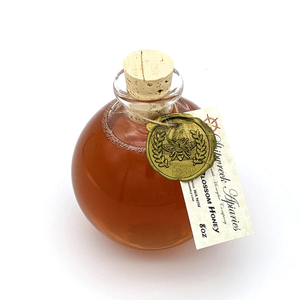 Shipwreck Apiaries Raw Honey 8oz glass flagon in both Blackberry Blossom Honey or Wildflower Blossom Honey top view