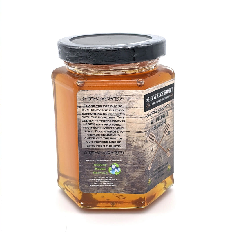 Shipwreck Honey Raw Honey 9oz hex jars in signature Wildflower Blossom Honey side thank you for buying our honey and directly supporting our efforts with the honeybee.