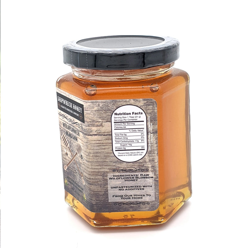 Shipwreck Honey Raw Honey 9oz hex jars in signature Wildflower Blossom Honey Side Label Nutritional Facts