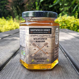 Shipwreck Honey Raw Honey 9oz hex jars in signature Wildflower Blossom Honey Front Label Outdoors - A Seattle Honeybee Company