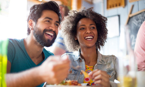 a couple enjoying food together - 8 Ways Cannabis Can Improve Your Relationship