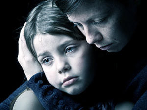 Cannabis Treatment for Chronic Pains-mother consoling daughter