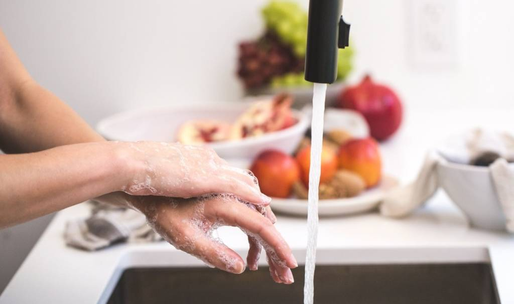 Washing hands for COVID-19 prevention.