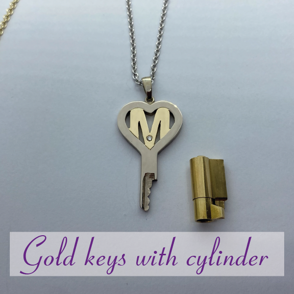 14 carat gold chastity keys with cylinder lock