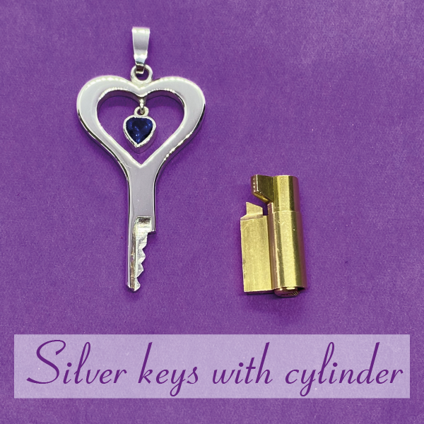 Silver chastity keys with cylinder lock