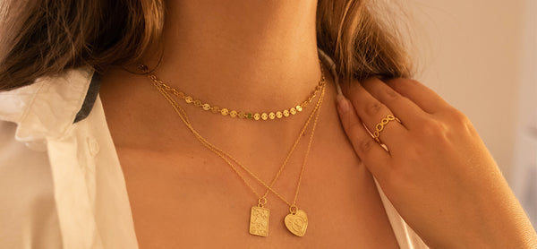 Women wearing shiny gold necklaces