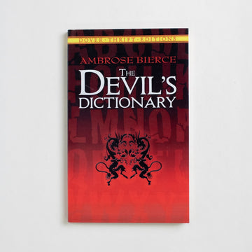 The Devil's Dictionary (Dover Thrift) by Ambrose Bierce, Dover Publications, Trade Softcover from A GOOD USED BOOK.  2014 No Stated Printing Reference Humor
