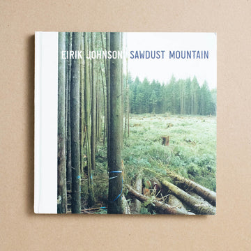 Sawdust Mountain by Eirik Johnson, Aperture Foundation, Oversize Hardcover from A GOOD USED BOOK.