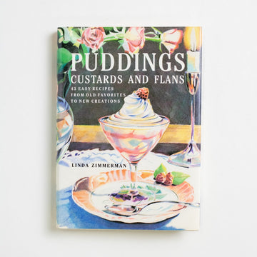 Puddings, Custards and Flans by Linda Zimmerman, Clarkson N. Potter, Small Hardcover w. Dust Jacket from A GOOD USED BOOK. 43 easy recipes from old favorites to new creations 1990 1st Edition, 1st Printing Reference