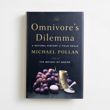 The Omnivore's Dilemma: A Natural History of Four Meals (Hardcover) by Michael Pollan, Penguin, Hardcover w. Dust Jacket from A GOOD USED BOOK.  2006 29th Printing Reference