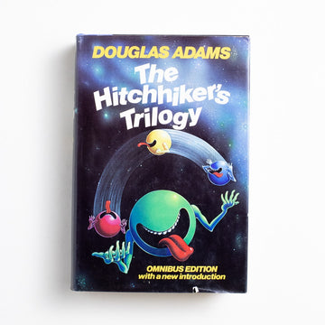 The Hitchhiker's Trilogy: Omnibus Edition by Douglas Adams, Harmony Books, Large Hardcover w. Dust Jacket from A GOOD USED BOOK. Beloved the world over, a single copy of