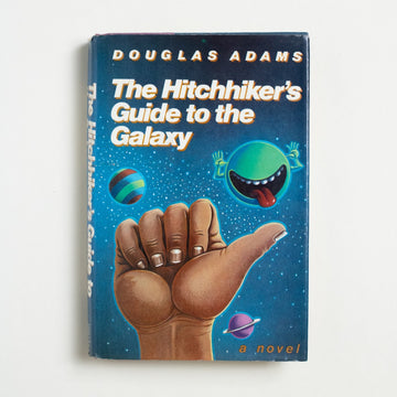 The Hitchhiker's Guide to the Galaxy (Hardcover) by Douglas Adams, Harmony Books, Hardcover w. Dust Jacket from A GOOD USED BOOK.  1979 1st American Edition Published by Harmony Books Genre Fiction Series